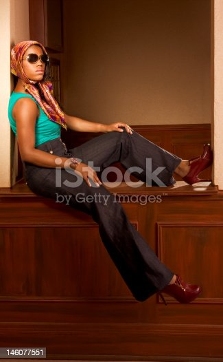 istock Urban African-American woman in jeans sitting on countertop 146077551
