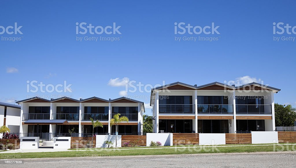 Urban Apartment Building with clear blue sky stock photo