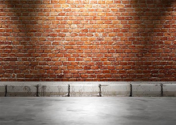 Urban background. Brick wall under the lamp light at night. stock photo