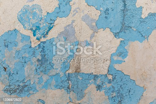 Painted distressed wall surface. Urban background grunge wall texture - old bricks and paint cracked wall texture