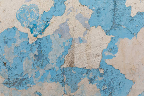 Urban background grunge wall texture - old bricks and paint cracked wall texture stock photo