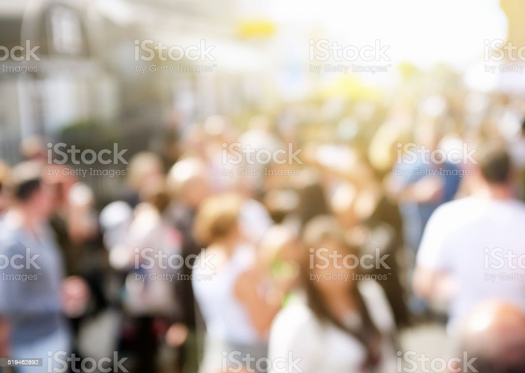 Urban background of a defocussed crowd of people in street stock photo