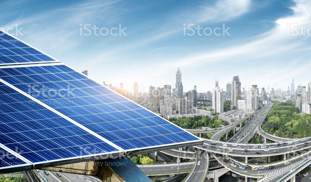 Urban background solar panels, Shanghai, China. stock photo