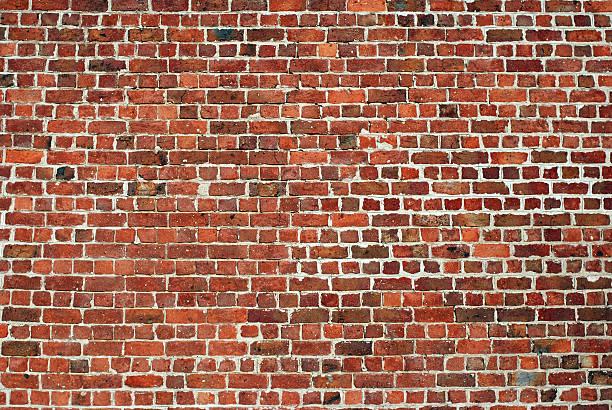 Urban background UK - Red brick wall stock photo