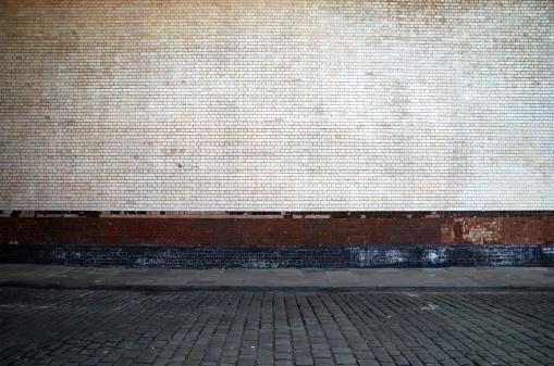 Wall and sidewalk