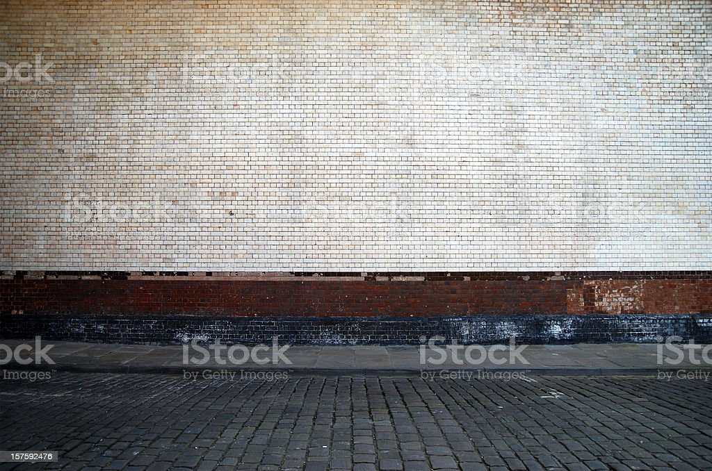 Urban background UK - White brick wall with sidewalk stock photo