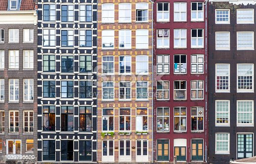 Urban background with residential building windows in Amsterdam, Netherlands