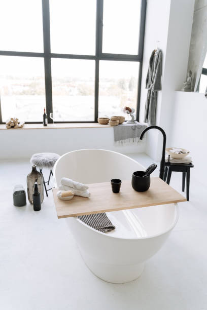 Urban Bathroom With Oval Bathtub Window Background stock photo