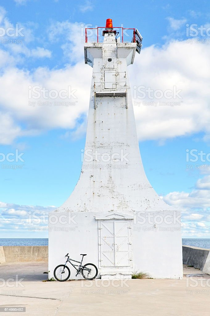 Urban bike rest at the harbour pier lighthouse. stock photo