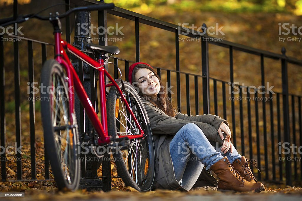 Urban biking - girl and bike in city royalty-free stock photo
