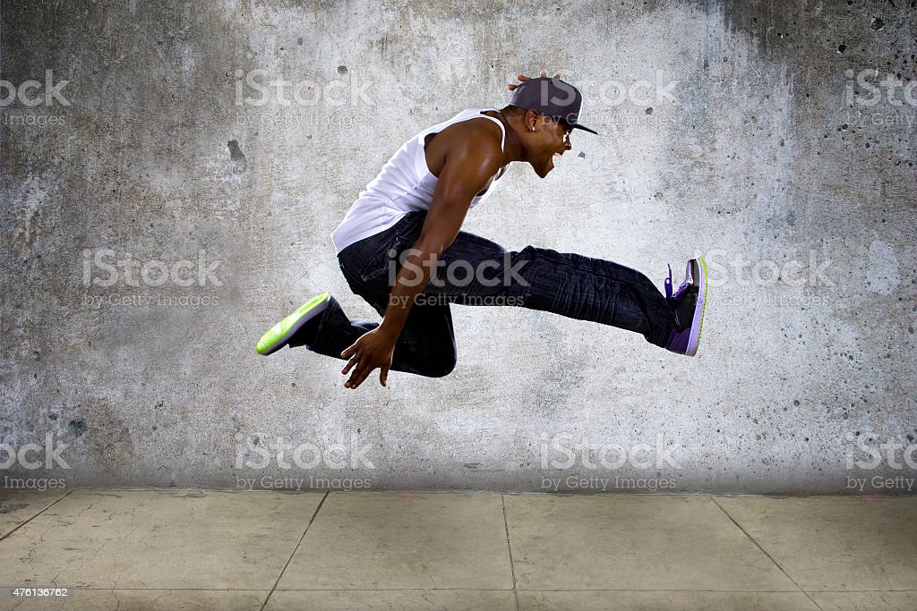 Urban Black Man Jumping High stock photo