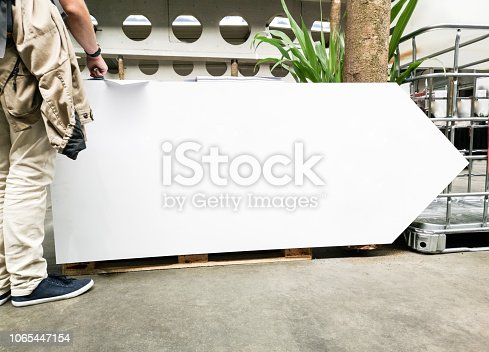 istock Urban blank empty direction sign 1065447154