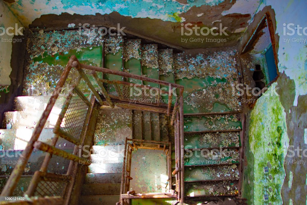 Urban blight -  old stairway in a condemned historic building in Weston, Wv. stock photo