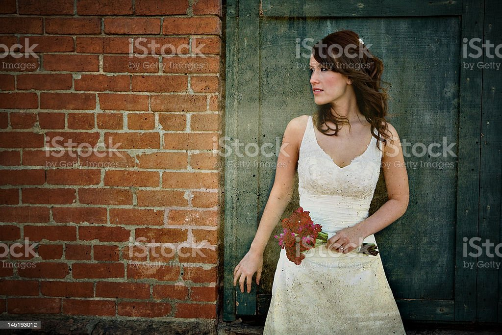 Urban Bride Bride poses in front of grungy wall Adult Stock Photo