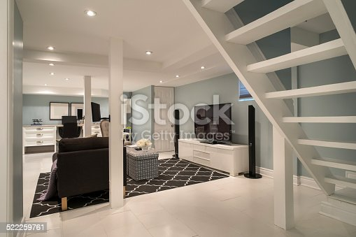 Interior of bungalow style city house in Toronto, Canada. This is a 80 years old house, completely renovated for modern family living. Nice mixture of old architecture of the house and contemporary design details. House features two bedrooms on a main floor and one in the fully finished basement.