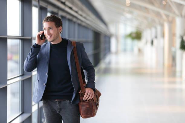 Urban business man talking on smart phone stock photo