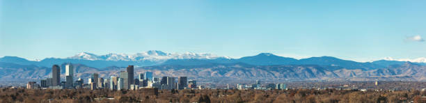 Urban City View of Denver Colorado Skyline Looking West Toward the Rocky Mountains on the Skyline stock photo