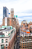 New York City, USA - April 7, 2018: Vertical view of urban cityscape rooftop building skyscrapers in NYC Herald Square Midtown with Macy's store and construction