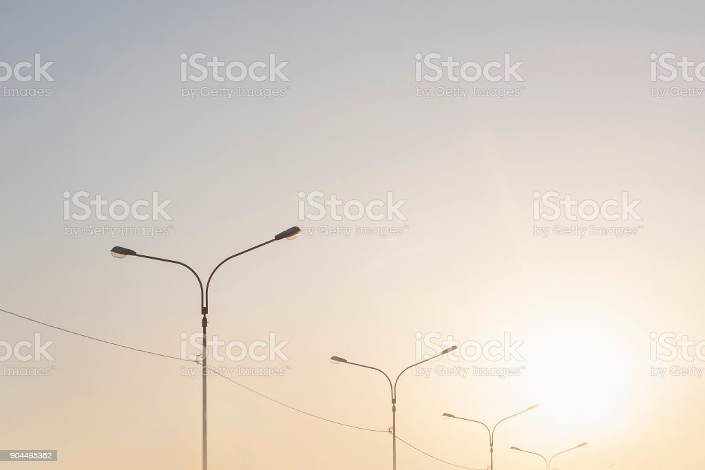 Urban clean sky with lamp pillars in sunset time royalty-free stock photo