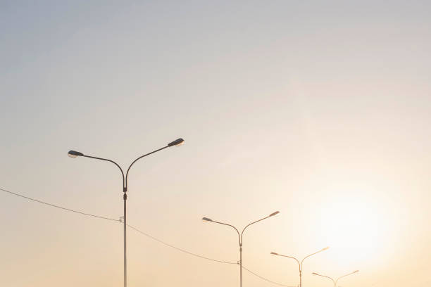 Urban clean sky with lamp pillars in sunset time stock photo