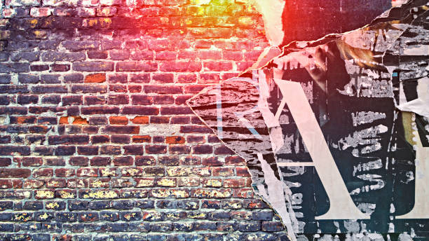 Urban Concrete Brick Wall With Copy Space Urban Concrete Brick Wall With Copy Space. Grunge old wall with torn posters as creative and abstract background. street art stock pictures, royalty-free photos & images
