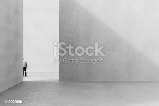 istock Urban concrete environment with sad businessman leaving 1045002998