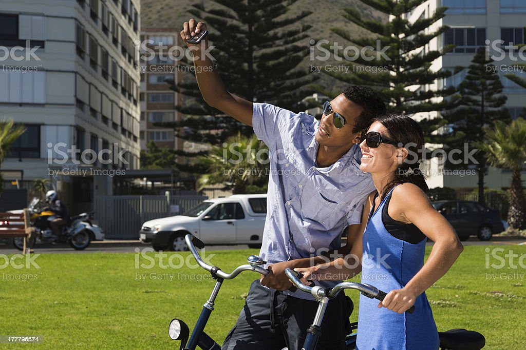 Urban Couple with Bicycles Take Photo of Themselves stock photo