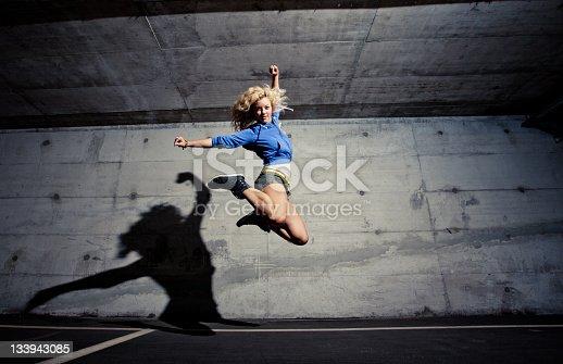 Girl jumping at the garage