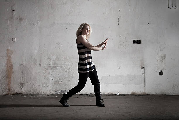 Urban dancing girl Girl dancing - muted tone new age music stock pictures, royalty-free photos & images