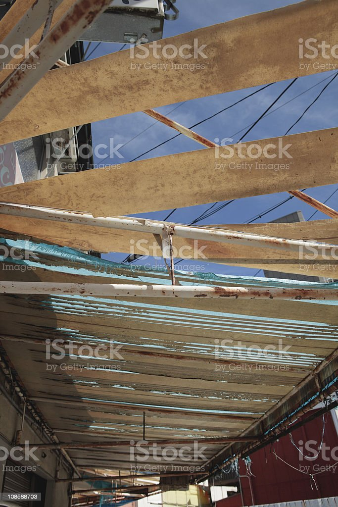 Urban decay in the shape of delapidated shop awnings stock photo