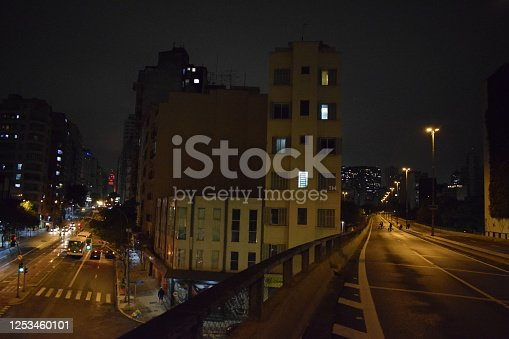 599471112 istock photo Urban elevated road in the night. Street light in city viaduct. Via Elevado Presidente Joao Goulart (Minhocao em Sao Paulo) 1253460101