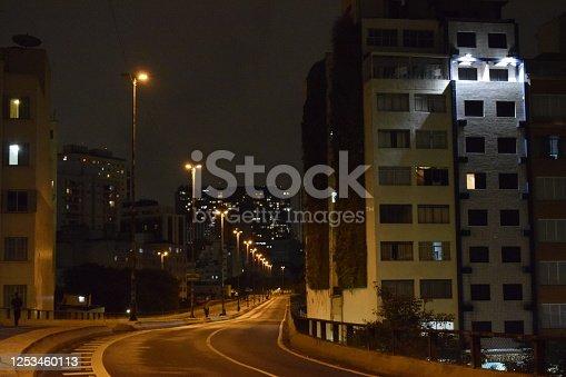 599471112 istock photo Urban elevated road in the night. Street light in city viaduct. Via Elevado Presidente Joao Goulart (Minhocao em Sao Paulo) 1253460113