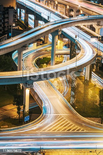 599471112 istock photo Urban elevated road junction and interchange overpass at night 1136575672