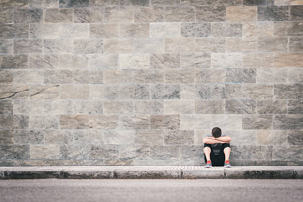 urban exhausted fitness man outdoor sitting on the floor - disappointment stock pictures, royalty-free photos & images