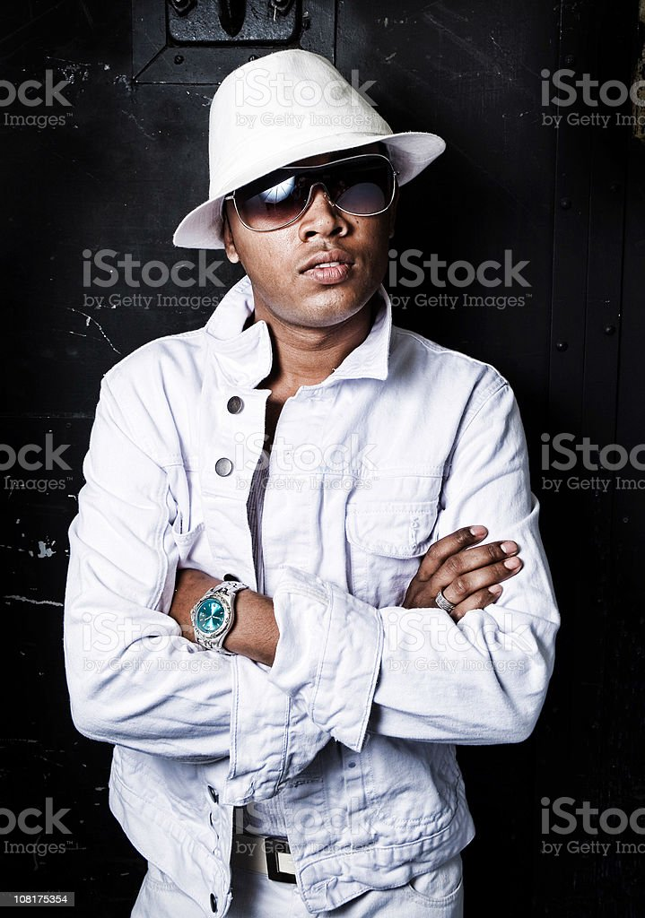 Urban Gangster Man Wearing White Clothing and Hat royalty-free stock photo