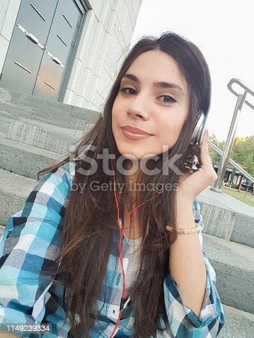 Urban girl making selfies downtown