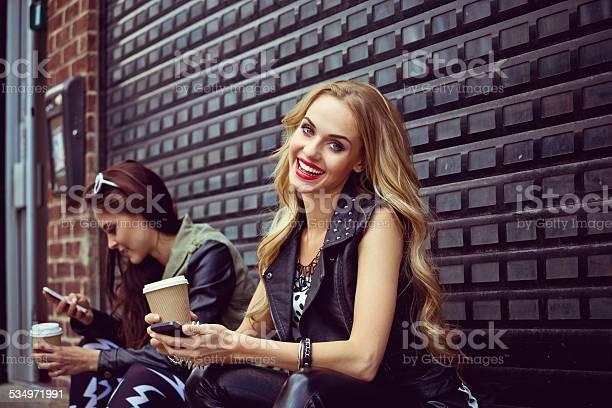 Urban Girls Using Smart Phones Stock Photo - Download Image Now