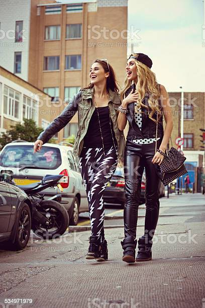 Urban Girls Walking Down The Street Stock Photo - Download Image Now