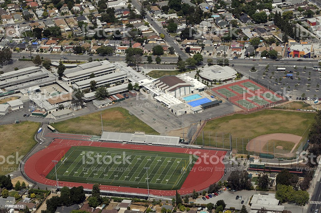 urban high school with sports fields aerial view stock photo
