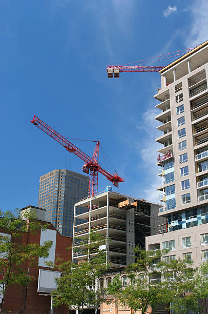 Urban Highrise Construction Buildings and Cranes stock photo