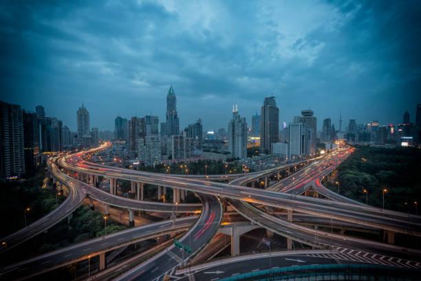 Urban highway traffic of shanghai at night stock photo