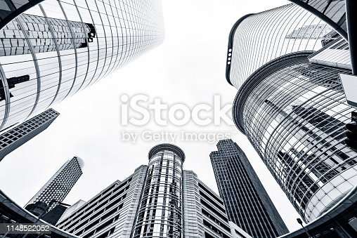 The lines of downtown skyscrapers moving upwards in a toned black and white as an interesting architectural abstract.
