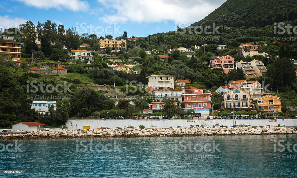 Urban landscape and the sea at sunset in Fiscardo, Kefalonia, stock photo