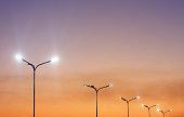 istock Urban landscape with modern minimal street lights and vibrant sky 1175523021