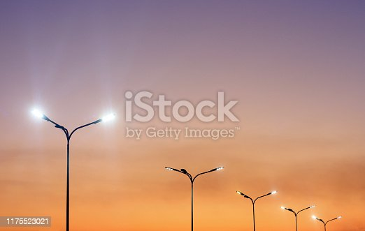 Urban landscape with modern minimal street lights and vibrant sky. Vivid city background.