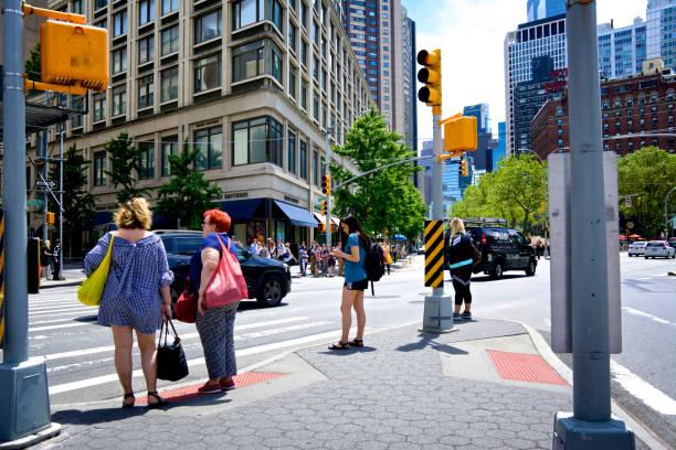 Urban Life, Female pedestrians waiting to cross Columbus Ave., Upper West Side, Manhattan, New York City, USA stock photo