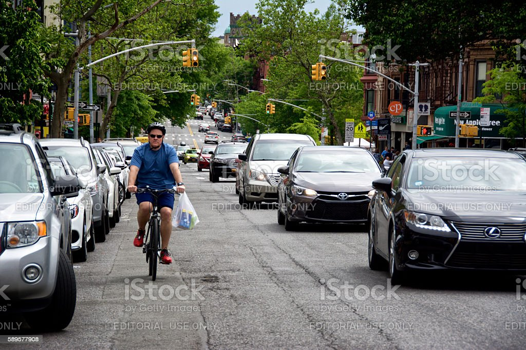 Urban Life, New York City, Male Bicyclist Near Vehicles, Brooklyn stock photo