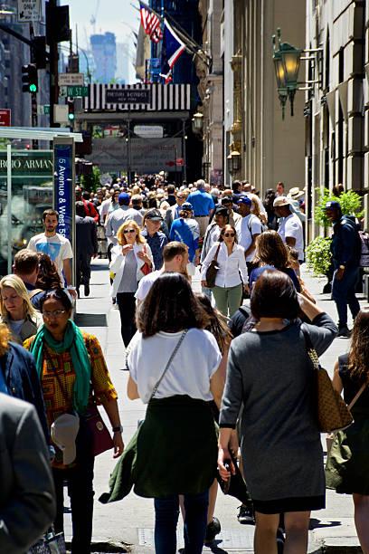 Urban Life, New York City, Pedestrians Walking along 5th Avenue stock photo
