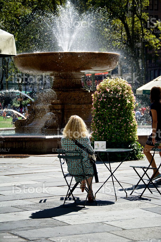 Urban Life, New York City, Woman Relaxing, Bryant Park, Manhattan stock photo