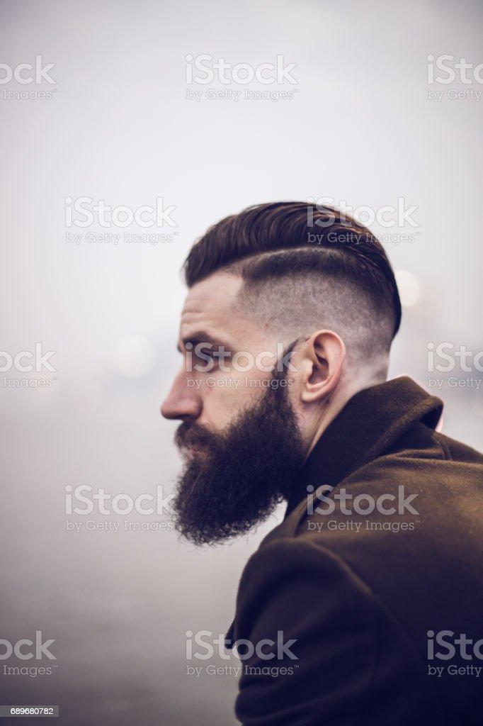 Urban man with beard stock photo